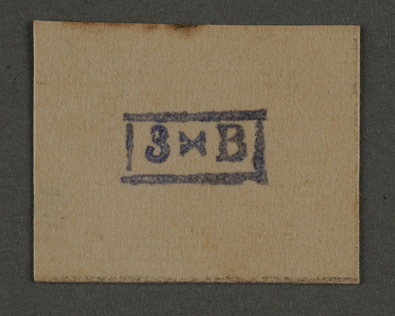 1995.89.944 front Ink stamp impression from an administrative department of the Kovno ghetto