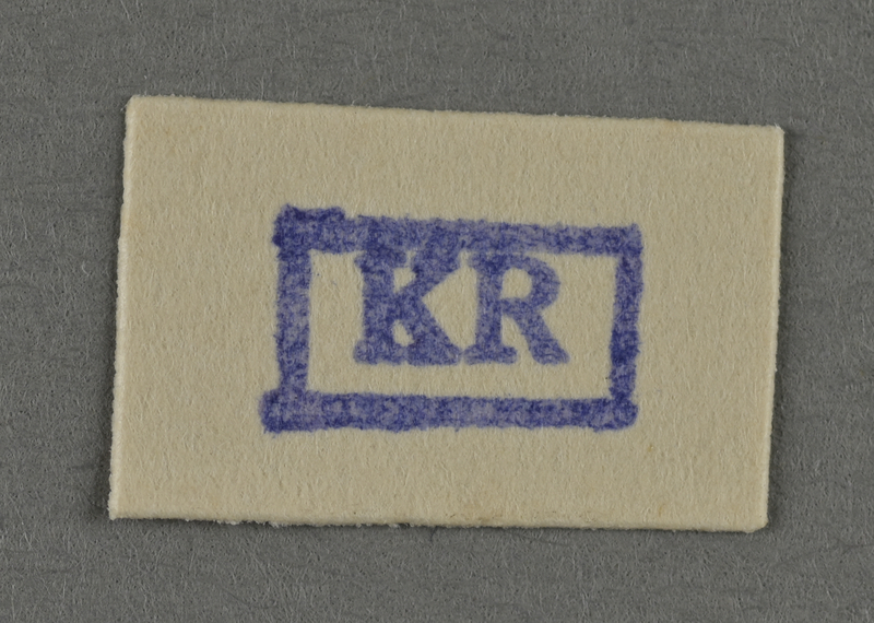 1995.89.956 front Ink stamp impression from an administrative department of the Kovno ghetto