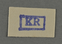 1995.89.956 front Ink stamp impression from an administrative department of the Kovno ghetto  Click to enlarge