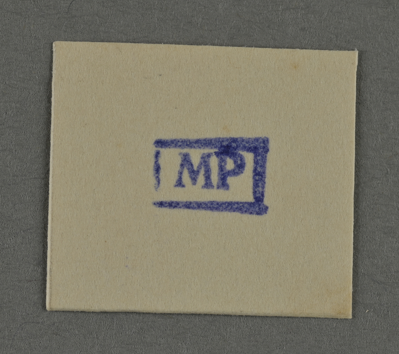 1995.89.961 front Ink stamp impression from an administrative department of the Kovno ghetto