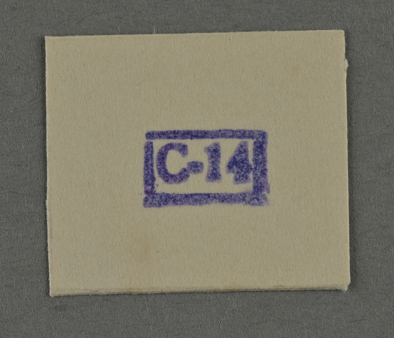1995.89.963 front Ink stamp impression from an administrative department of the Kovno ghetto