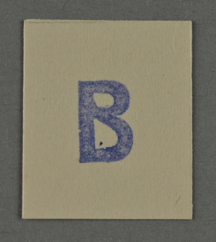 1995.89.967 front Ink stamp impression from an administrative department of the Kovno ghetto