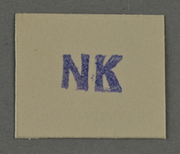 1995.89.979 front Ink stamp impression from an administrative department of the Kovno ghetto  Click to enlarge