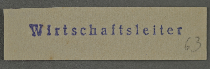 1995.89.991 front Ink stamp impression from an administrative department of the Kovno ghetto