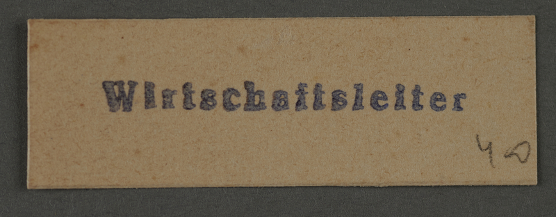1995.89.992 front Ink stamp impression from an administrative department of the Kovno ghetto