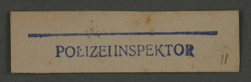 1995.89.994 front Ink stamp impression from an administrative department of the Kovno ghetto