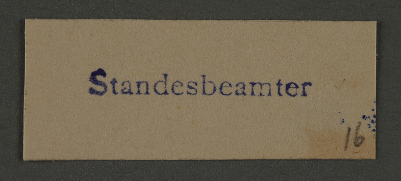 1995.89.995 front Ink stamp impression from an administrative department of the Kovno ghetto
