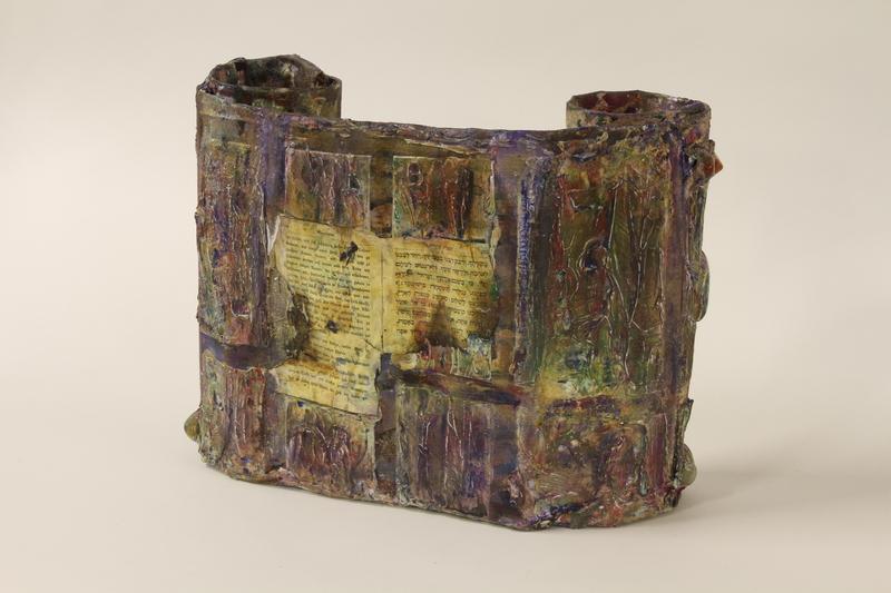 1995.94.1 back Mixed media sculpture representing a rescued Torah scroll