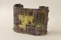 1995.94.1 back Mixed media sculpture representing a rescued Torah scroll  Click to enlarge