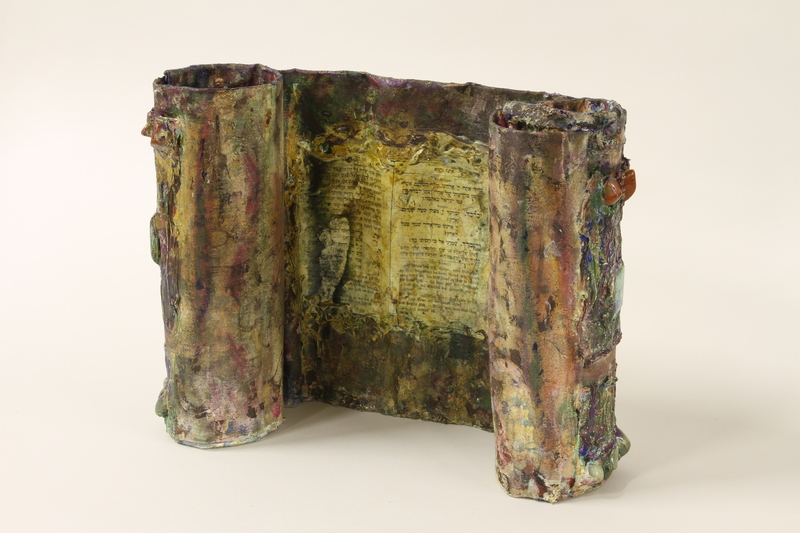 1995.94.1 front Mixed media sculpture representing a rescued Torah scroll