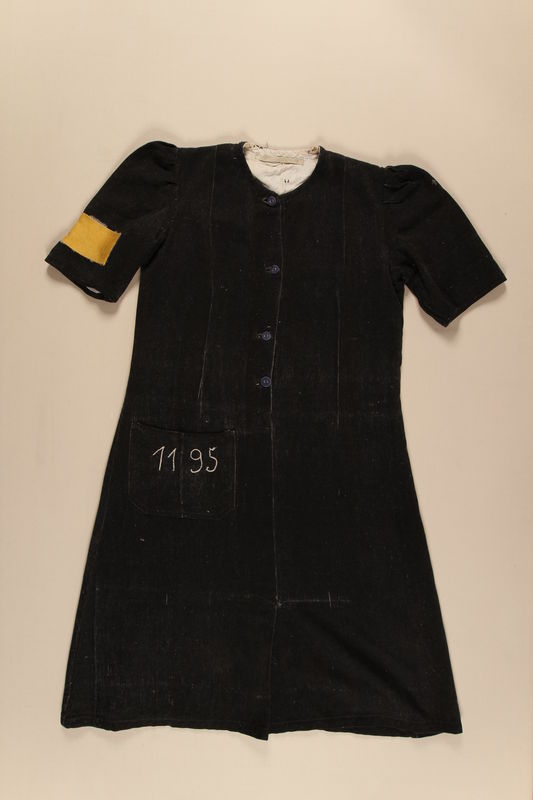 1995.95.1_a front Grey dress with prison number 1195 and id tag worn by a Jehovah's Witness inmate