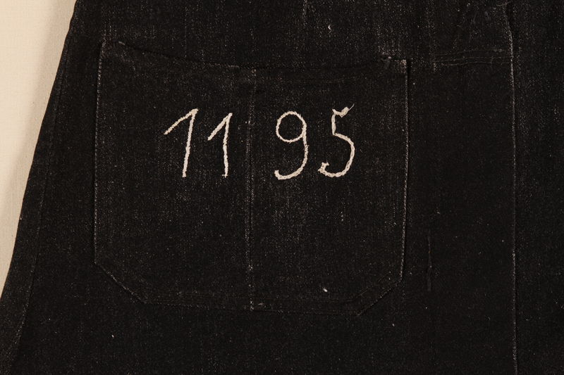 1995.95.1_a detail 1 Grey dress with prison number 1195 and id tag worn by a Jehovah's Witness inmate