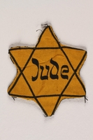 1996.118.1 front Star of David badge with Jude printed in the center  Click to enlarge
