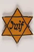 1996.13.6 front Star of David badge with Juif printed in the center  Click to enlarge