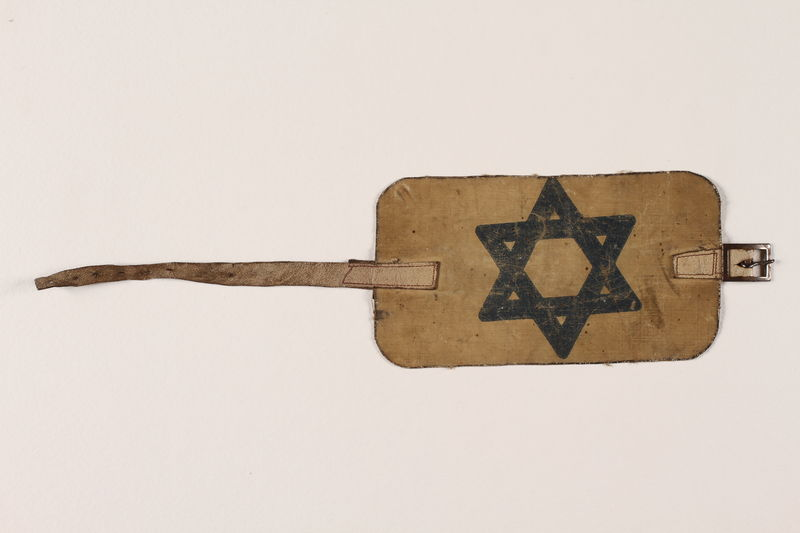 1996.146.1 front Armband with buckle and a blue Star of David