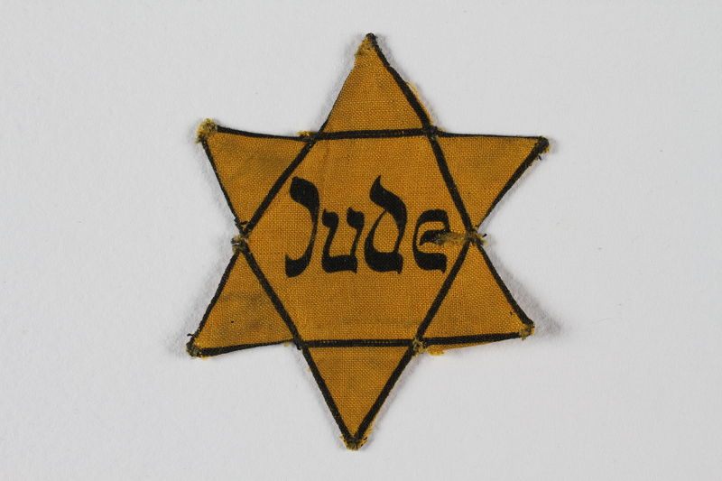 1996.146.2 front Star of David badge with Jude printed in the center