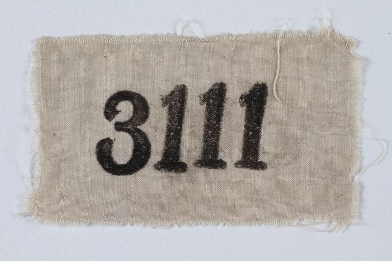 1996.146.3 front Prisoner identification badge