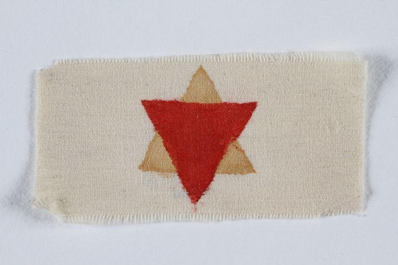 1996.146.4 front Prisoner identification badge