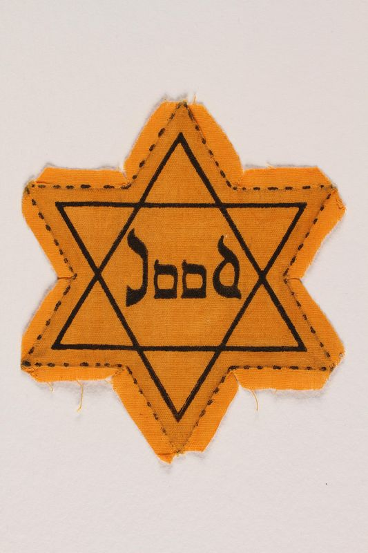 1996.151.1 front Star of David badge with Jood printed in the center
