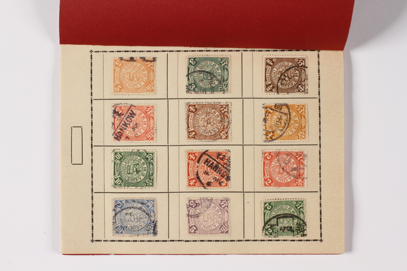 1996.19.17 open Stamp booklet with cancelled Republic of China postage stamps