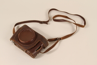 1996.19.30_a-b closed Leica camera and leather camera case  Click to enlarge