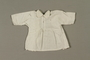 White blouse made for an infant born in a concentration camp