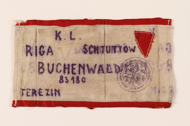 1989.317.1 front Armband inscribed with camp names where the Polish Jewish inmate was imprisoned