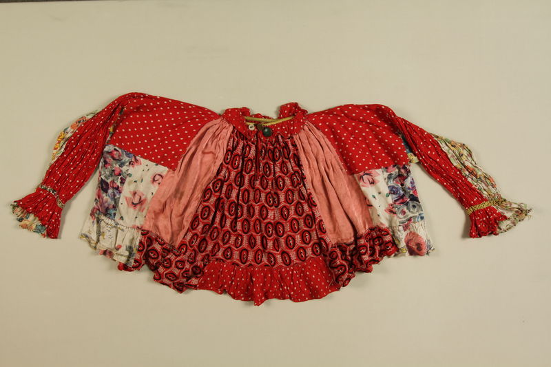 1989.319.1 front Red shirt worn by a Romanian Romani