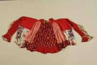 1989.319.1 front Red shirt worn by a Romanian Romani  Click to enlarge