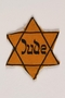Yellow cloth Star of David badge with the word Jude