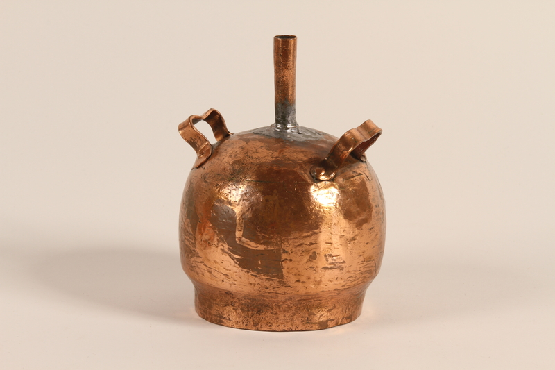 1989.319.10 b front Large pot used by a Romanian Romani as a distilling device for making peasant brandy
