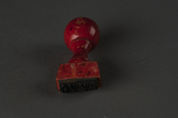 1996.28.19 back Rubber stamp acquired from the capture of a German army division  Click to enlarge