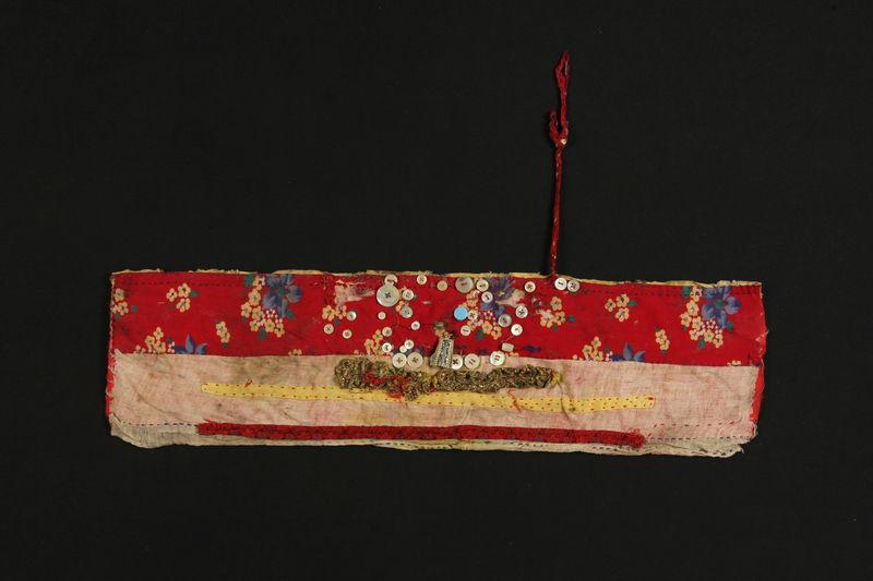 1989.319.6 front Headband (Sihon) worn by a Romanian Romani woman