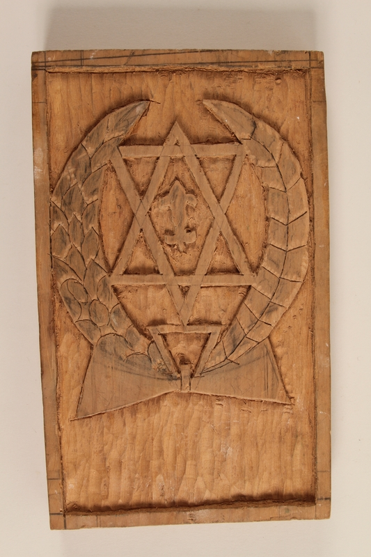 1996.38.1 front Wooden plaque with the Hashomer Hatzair emblem given to a US soldier