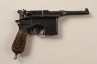 1996.4.9_a front Mauser 1896 revolver, firing pin, and holster taken by a US soldier from a German prisoner of war  Click to enlarge