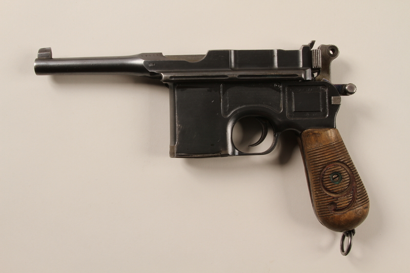 1996.4.9_a back Mauser 1896 revolver, firing pin, and holster taken by a US soldier from a German prisoner of war