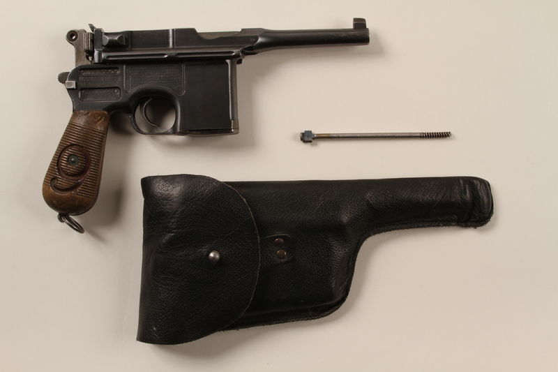 1996.4.9_a-c front Mauser 1896 revolver, firing pin, and holster taken by a US soldier from a German prisoner of war