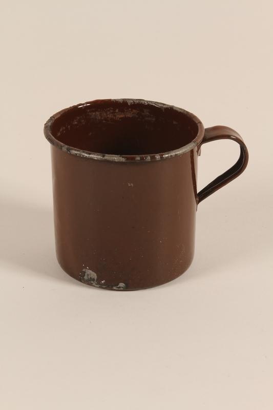 1996.5.1 front Brown enamel mug used by a Polish Jewish concentration camp prisoner
