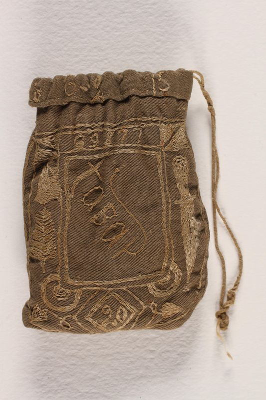 1996.59.14 back Hand-made tobacco pouch from Dachau concentration camp