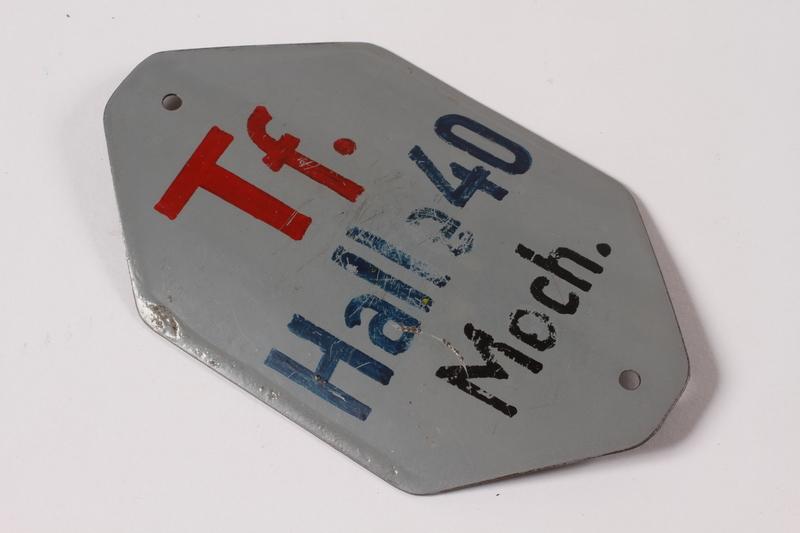 1996.73.1 front Prisoner identification badge
