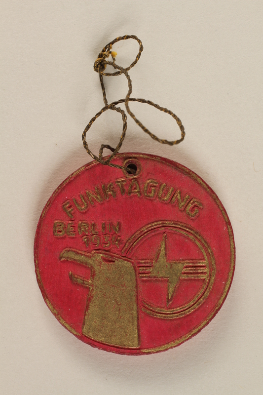 1996.75.10 front Nazi badge celebrating the Berlin Radio Convention of 1934