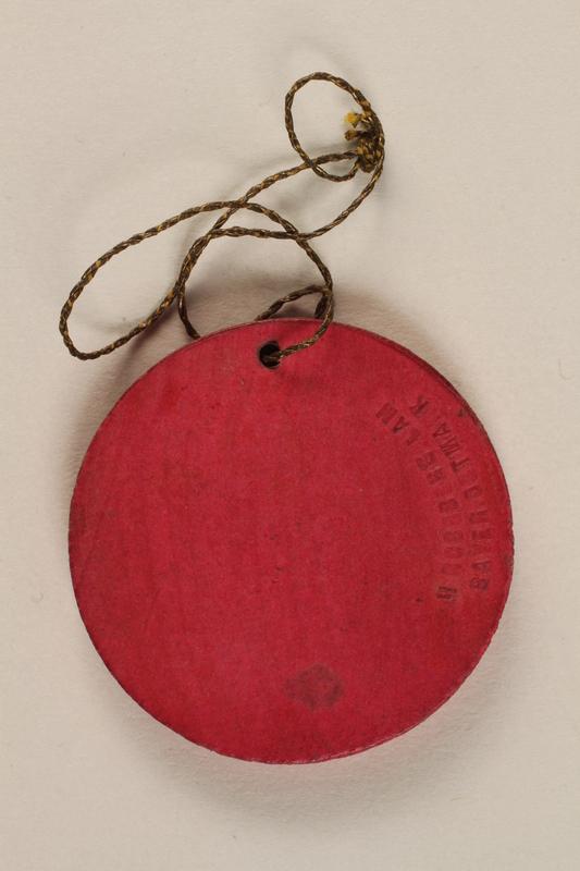 1996.75.10 back Nazi badge celebrating the Berlin Radio Convention of 1934