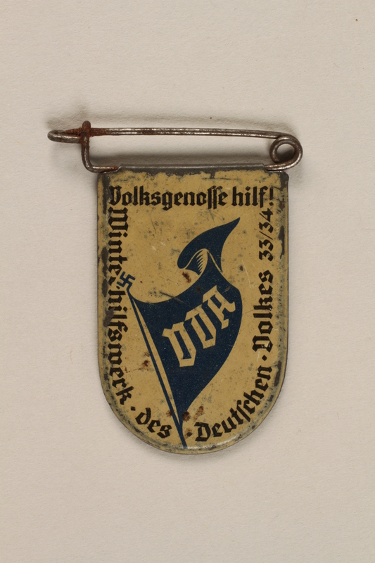 """1996.75.12 front Nazi """"Winter Relief"""" badge"""