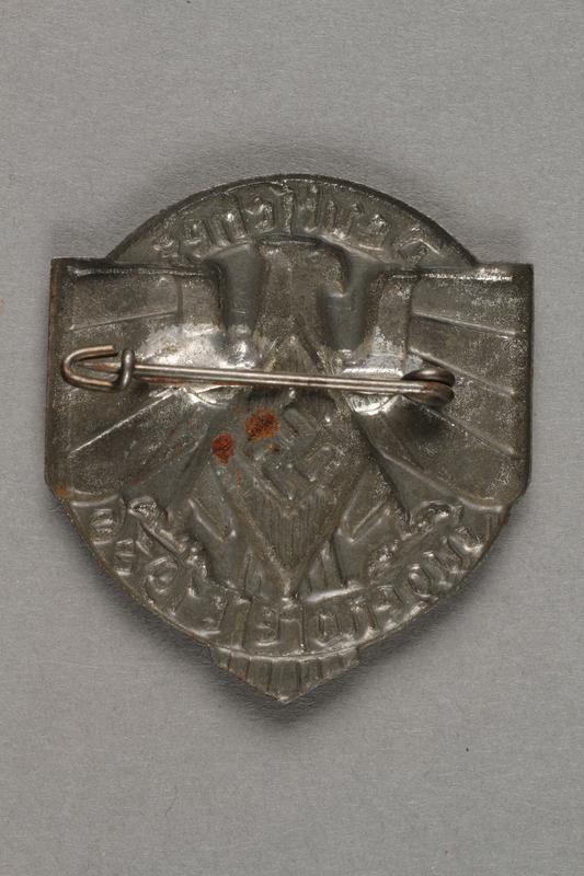 1996.75.19 back Hitler Youth [Hitler Jugend/Bund Deutscher Mädel] badge