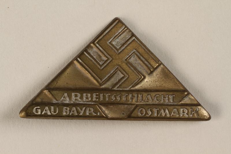 1996.75.24 front Nazi labor service badge