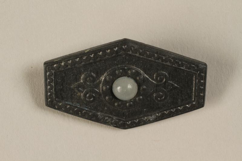 1996.75.28 front Nazi badge representing an ancient nordic war shield