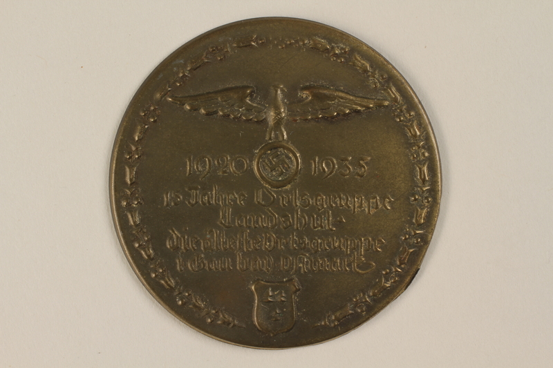 1996.75.31 front Anniversary badge from a local German Nazi Party organization