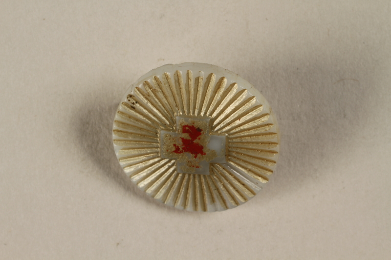 1996.75.54 front Red Cross badge