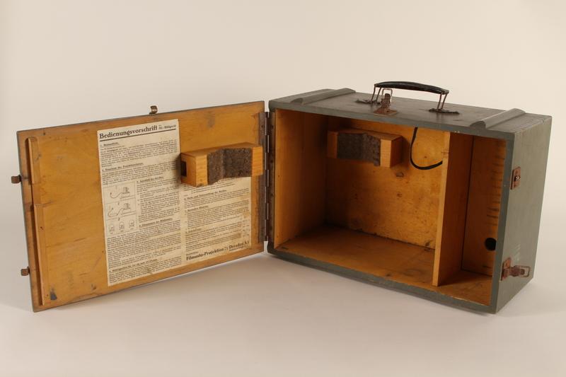 1996.77.1.2_a open Filmstrip projector case