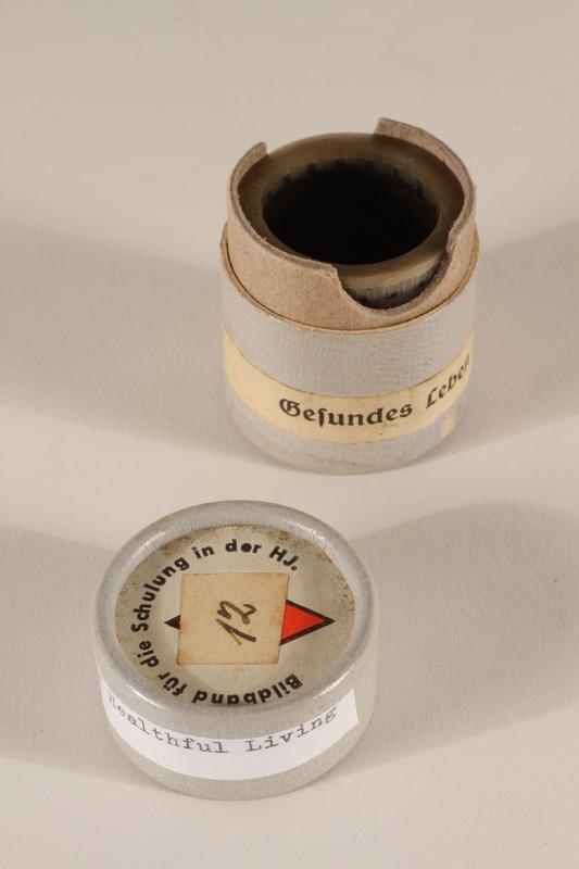 1996.77.11.2_a-b open Nazi propaganda filmstrip canister